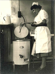 Dorothy using the steriliser
