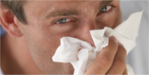 Male blowing nose