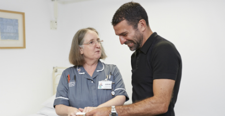 Benali with research nurse - web