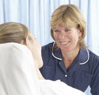 Nurse speaking to patient