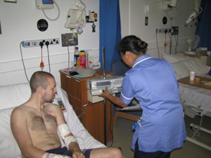 Patient Rob with staff nurse adjusting equipment