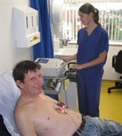Patient having ECG performed by cardiac physiologist