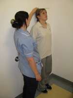 Patient's height being checked (photo by Jonathan Upton)