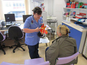 Staff nurse Jo Hall talking to patient