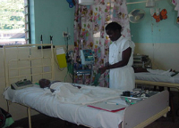 Child with malaria in a hospital bed