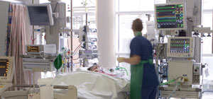 Nurse and patient in Cardiac Intensive Care Unit