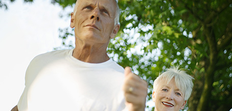 Elderly man and woman jogging_457x220