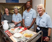 Mealtime assistants - photograph courtesy of the Daily Echo